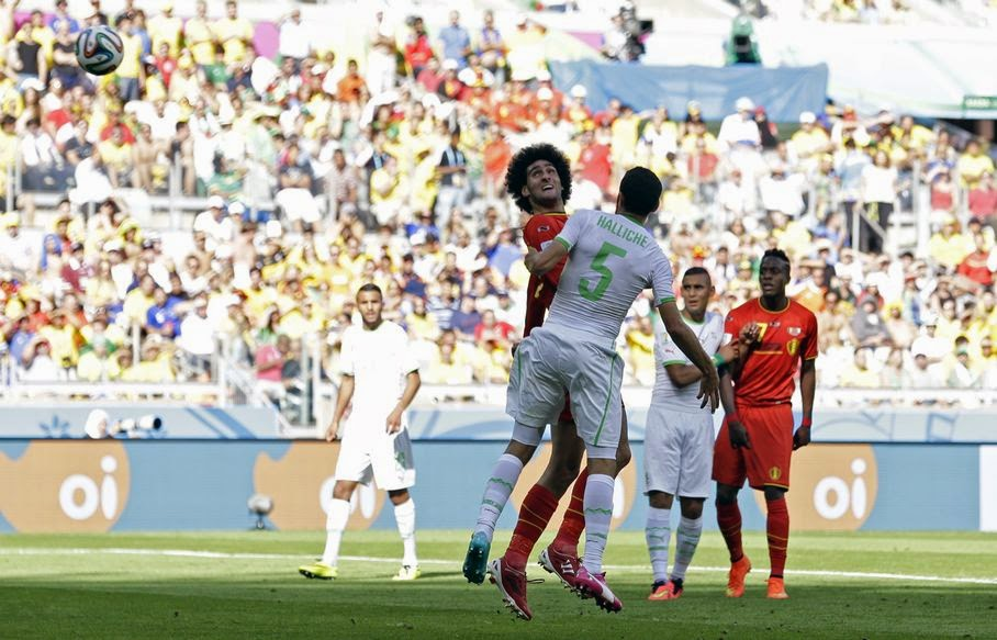 Belgium's Marouane Fellaini scores his side's first goal during the group H World Cup soccer match between Belgium and Algeria at the Mineirao Stadium in Belo Horizonte, Brazil, Tuesday, June 17, 2014.