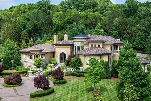A magnificent mediterranean villa with a porte cochere for Brentwood builders