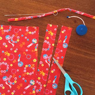 Cutting out fabric for a Japanese cotton necklace