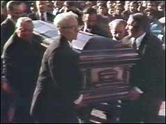 Gambino's coffin arrives at his funeral