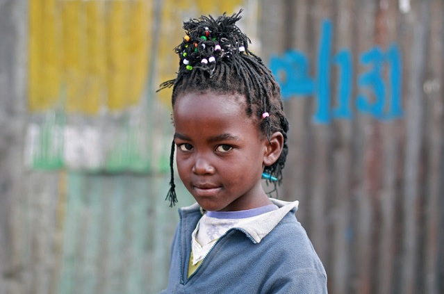 Little girl in the Slums of Kibera Kenya Africa