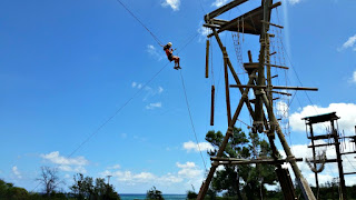 Camper on the monster ropes course swing at Aloha Beach Camp's Hawaii summer camp program.