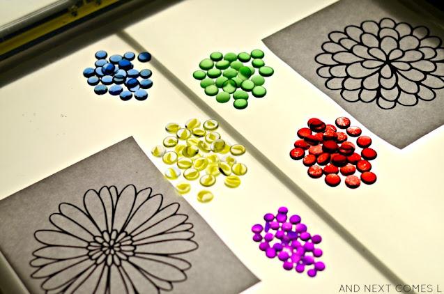 Colorful glass stones and flower mandala printable on a light table
