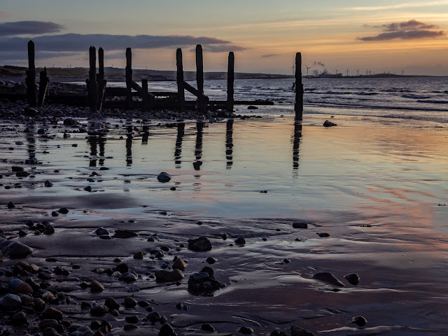 Photo of sunset reflected in the wet sand at Maryport