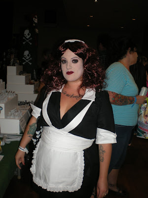 Convention attendee in Magenta maid costume from The Rocky Horror Picture Show.