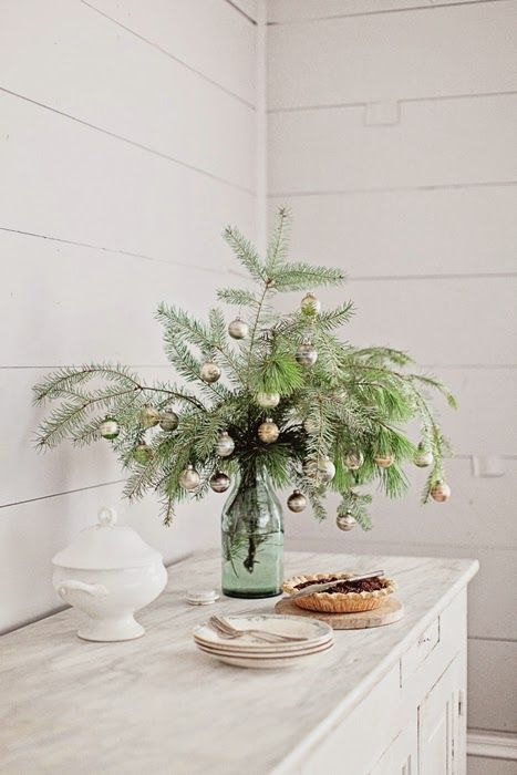 Antique painted shabby chic cabinet and mason jar with greenery in farmhouse Christmas holiday vignette