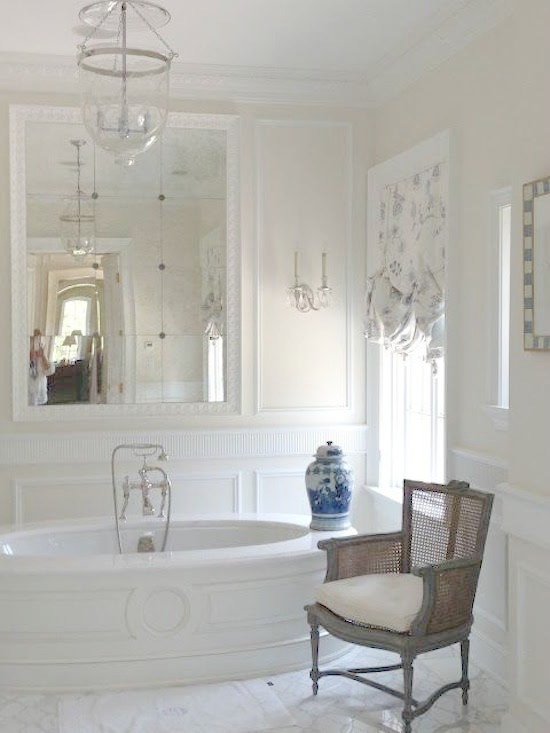 Luxurious bathtub and French inspired paneling in white Enchanted Home bathroom