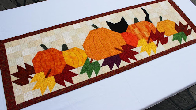 Pumpkat Patch table runner by QuiltFabrication