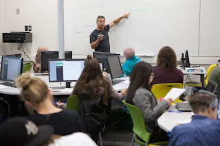 Professor Tom Harman conducts the first session of an ALEKS-based Math 105 class in UAA's new Math Emporium, located in the Learning Resources Center at Sally Monserud Hall. (Photo by Philip Hall/UAA)