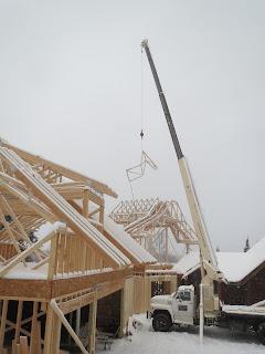 crane, frame trusses, lake home, ely mn