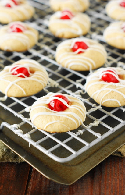 Cherry Almond Cookies ~ One adorable & tasty little treat!  Perfect for Christmas cookie trays, cookie exchanges, Valentine's Day treats, or for everyday enjoying.  www.thekitchenismyplayground.com