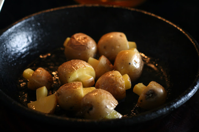 mushroom potatoes sizzling away in the pan
