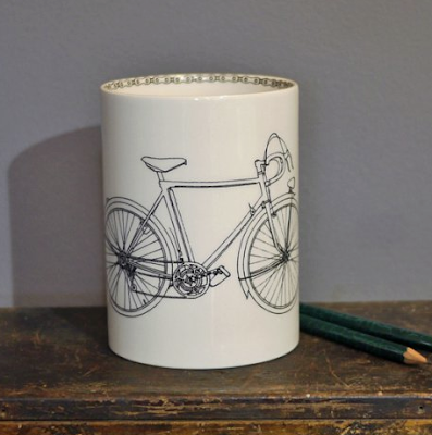 pencil cup with line drawing of a bicycle