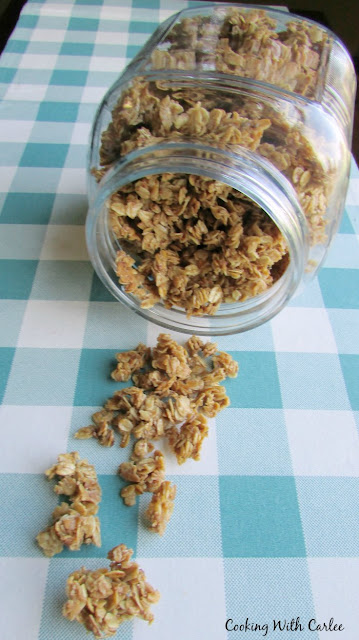 large jar of granola tipped over and spilling out