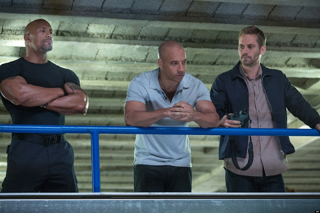 The three main dudes, Luke Hobbs (Dwayne Johnson), Dom (Vin Diesel) and Brian (Paul Walker)