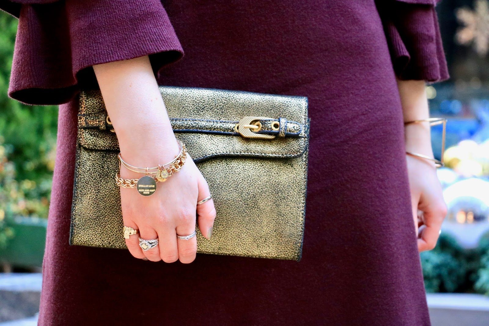 Nyc fashion blogger Kathleen Harper carrying a gold holiday clutch by Rebecca Minkoff
