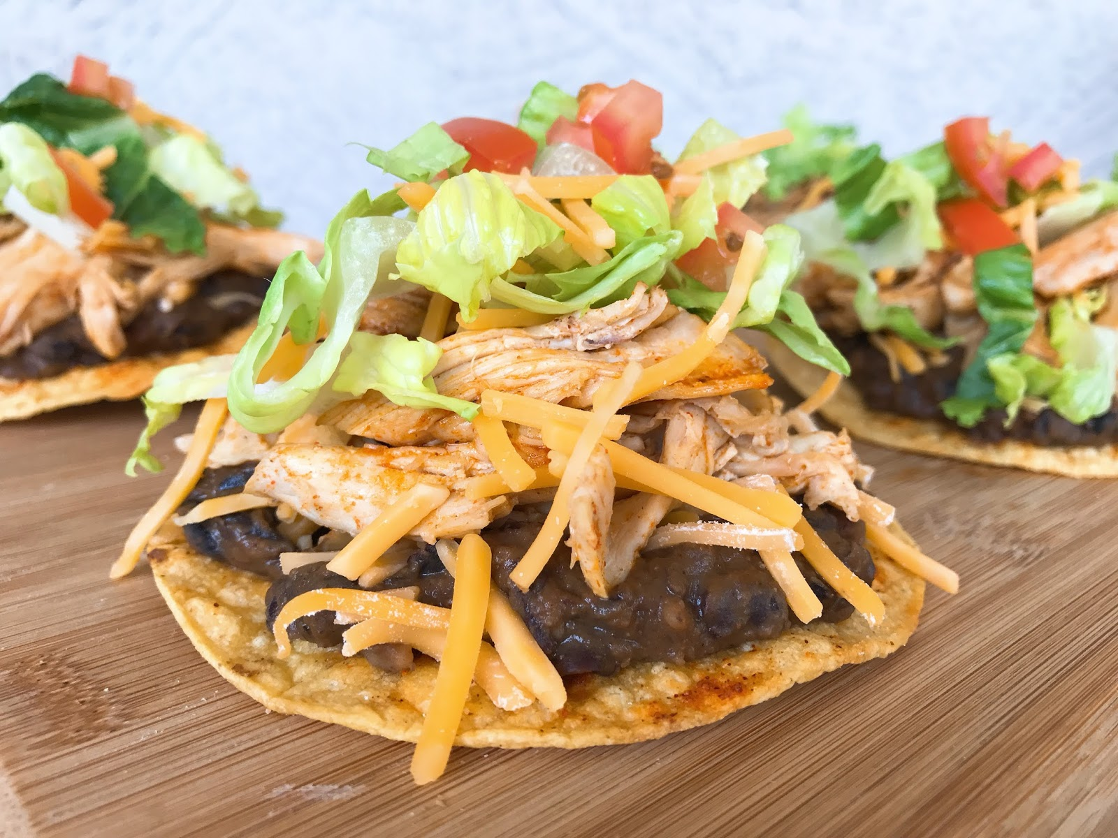 Tostadas With Refried Black Beans Chicken And Cheddar