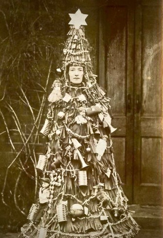 Sepia photo. Creepy person dressed as a Christmas Tree. A Pleasant Christmas Story and other stories of Christmas Creepers. marchmatron.com