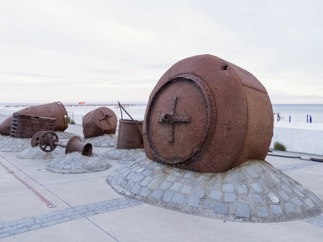 Rusty maritime equipment on the shores of the Strait of Magellan in Punta Arenas Chile