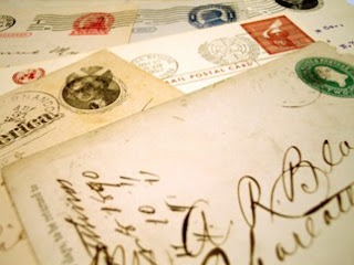 piles of letters with stamps