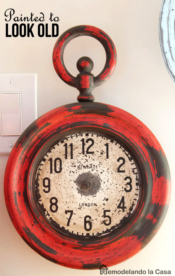 red metal clock with a painted vintage look