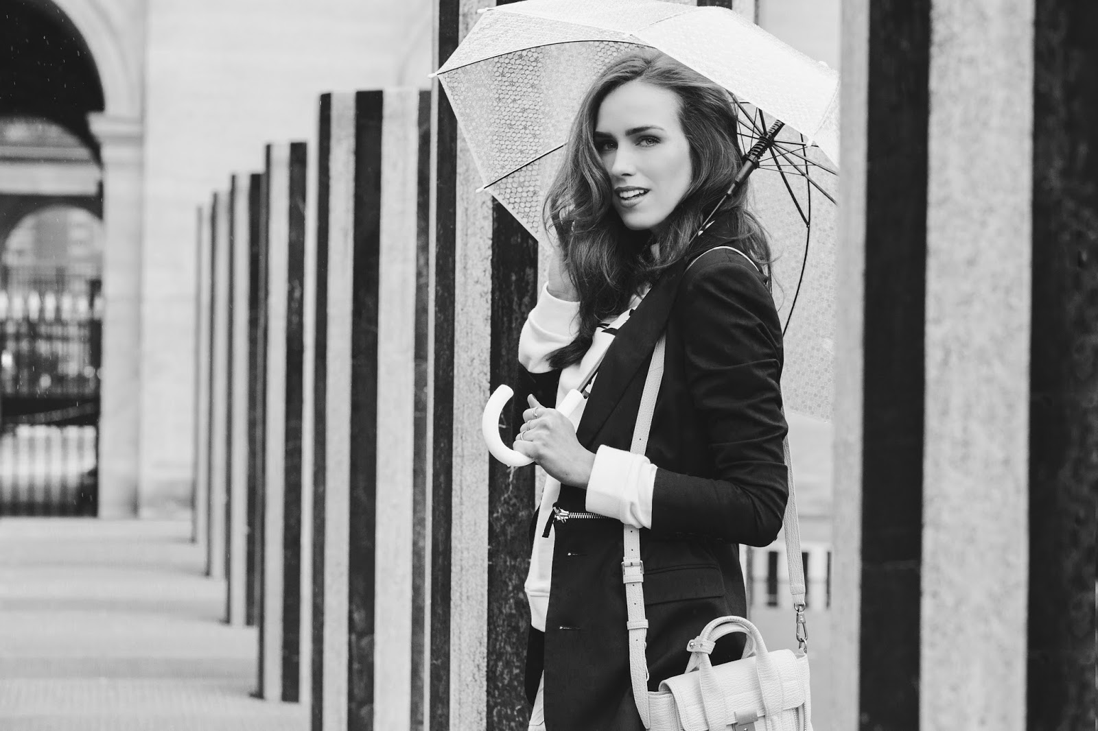 black white paris palais royal photoshoot rain