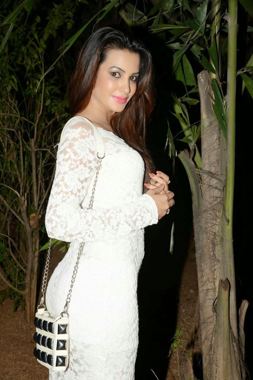 Actress Diksha Panth Wallpapers, Actress Diksha Panth Crossleg Sitting Pics in White Dress from Event