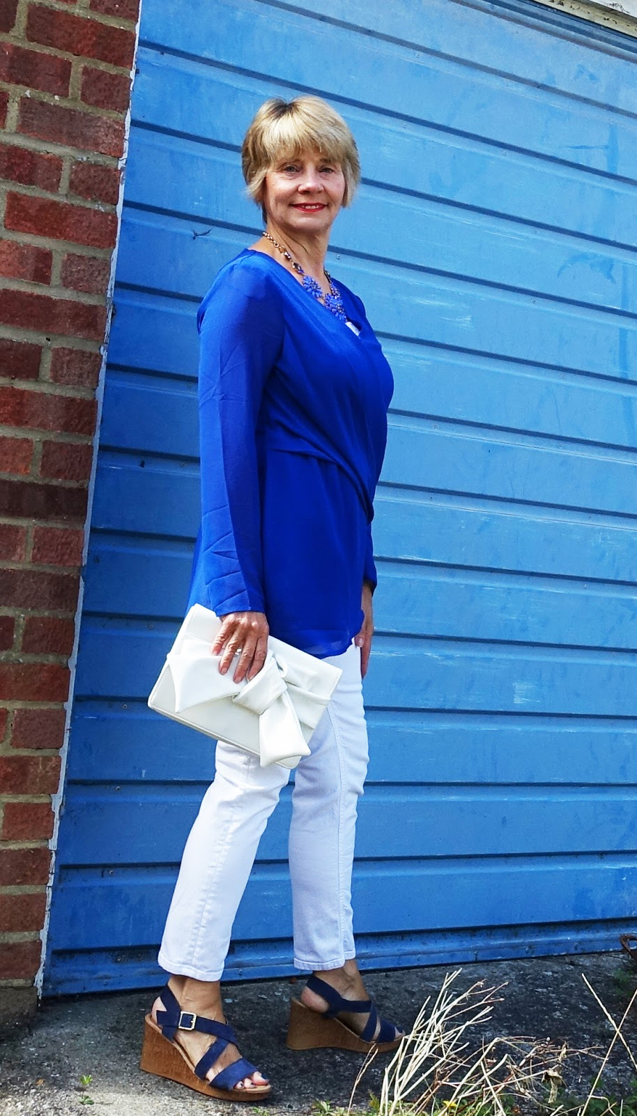 Patnering a drapey cobalt blue top with jeans gives it a casual but polished edge