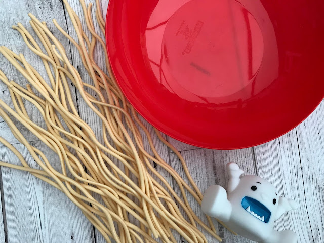Unboxed Yeti in My Spaghetti - red bowl, plastic spaghetti and yeti