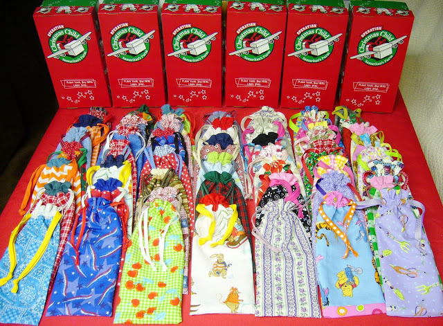 Fifty hand made pencil pouches for OCC shoe box packing.