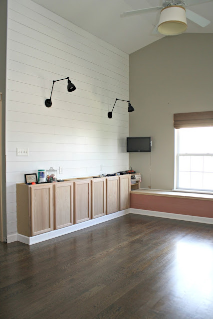 planked shiplap walls with sconces