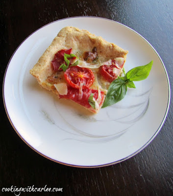 piece of tomato slab pie with fresh basil