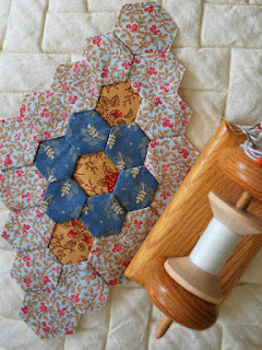 pieced hexagon quilt: QuiltBee