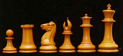 Pawn, Rook or Castle, knight, bishop, queen and king from a classic Staunton competition style chess set.