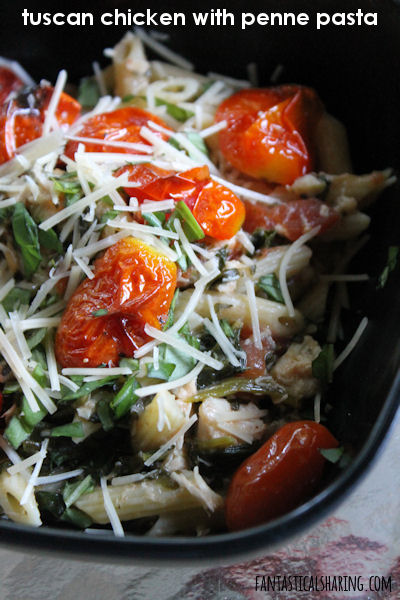 Tuscan Chicken with Penne Pasta // This pasta dish has a lovely sauce with loads of garlic, chicken, and Italian seasonings. #recipe #maindish #chicken #tomato #garlic #pasta
