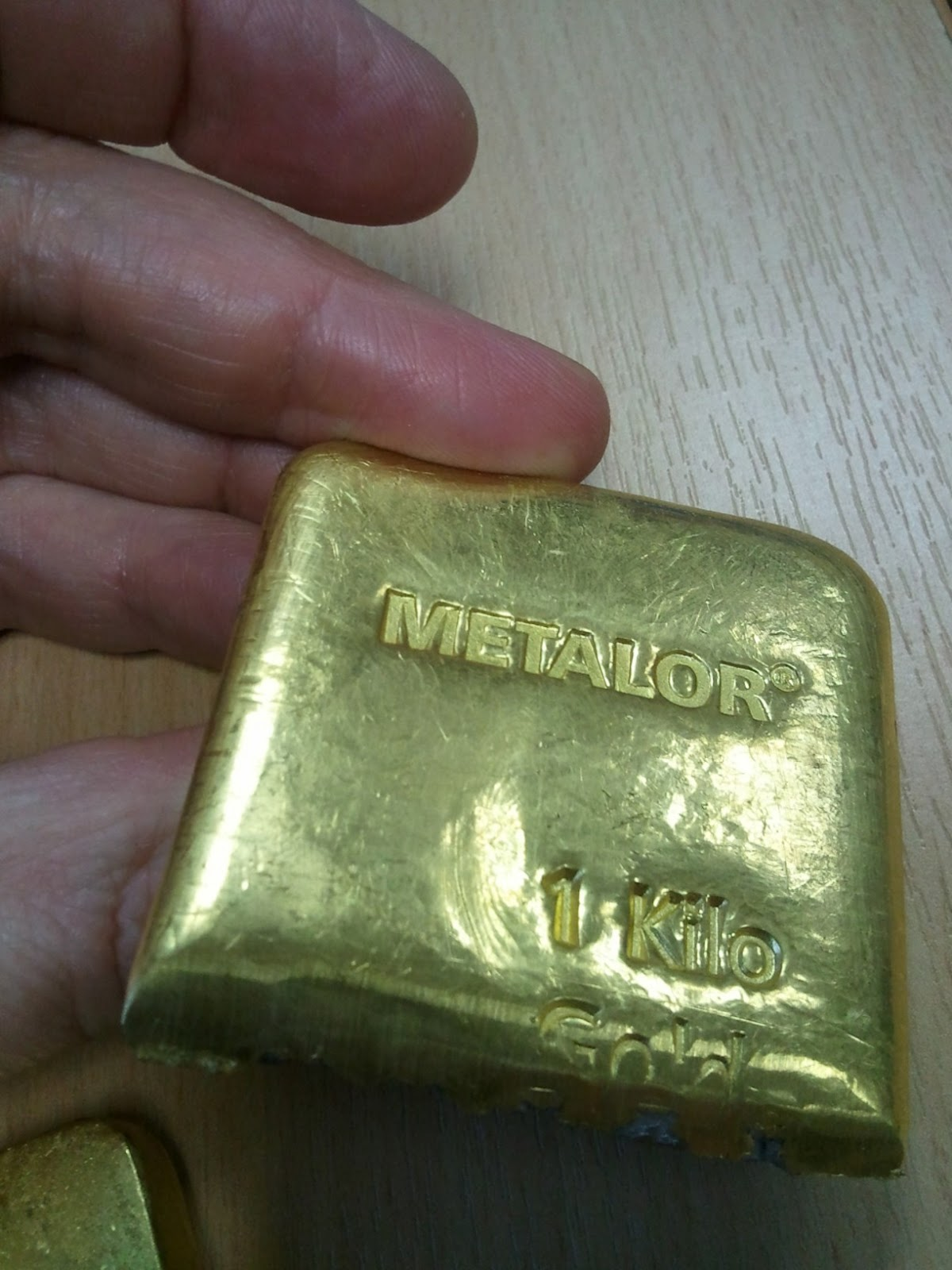 1000g Gold Bar Cut Showing Inserted Tungsten Rods The Two Halves Of