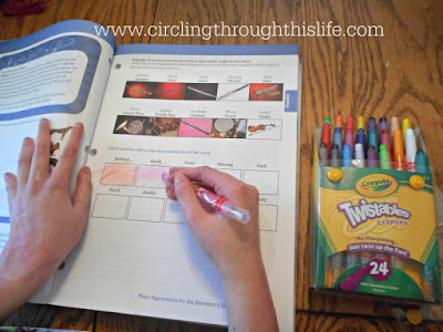 Supergirl completes a page in the activity book of this wonderful homeschool music curriculum #hsreviews Circling Through This Life