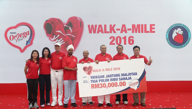 A cheque from Nestlé Omega Plus totalling RM30,000 to Yayasan Jantung Malaysia (YJM)