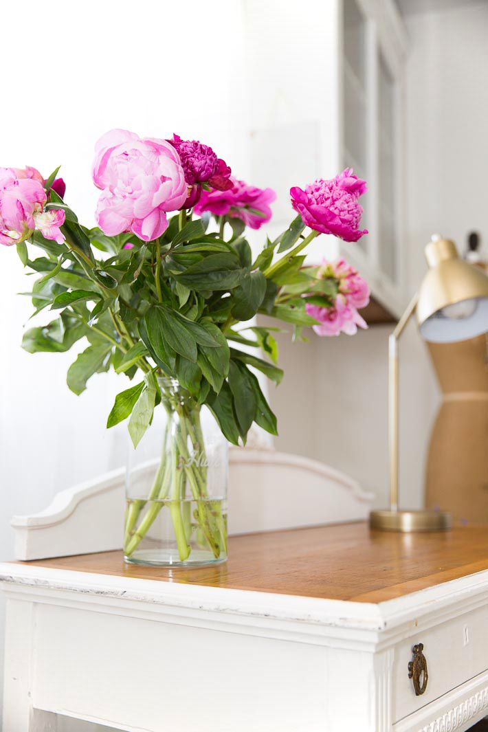 peonies on a french desk