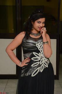 Shrisha Dasari in Sleeveless Short Black Dress At Follow Follow U Audio Launch 019.JPG