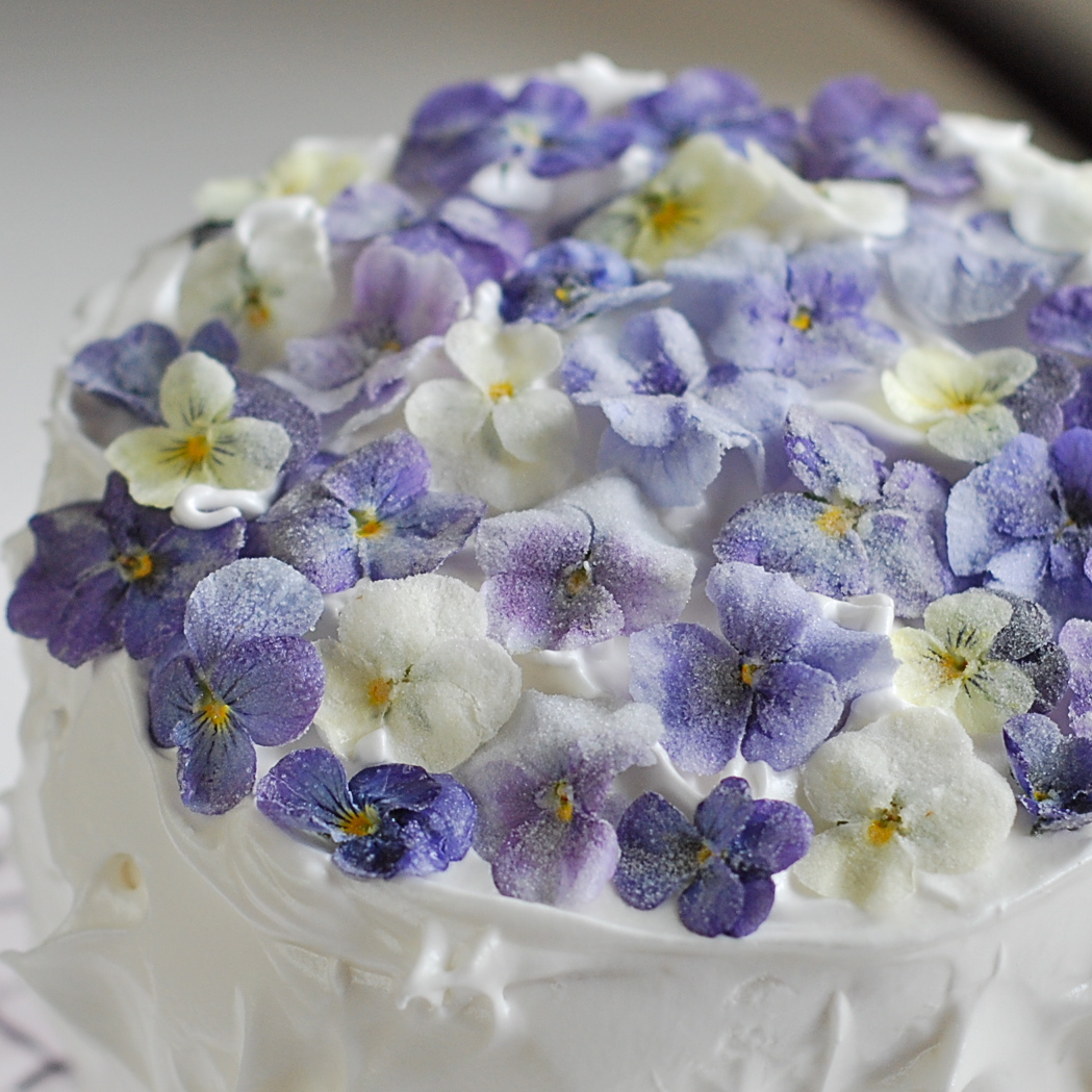 Decorating A Cake With Edible Flowers