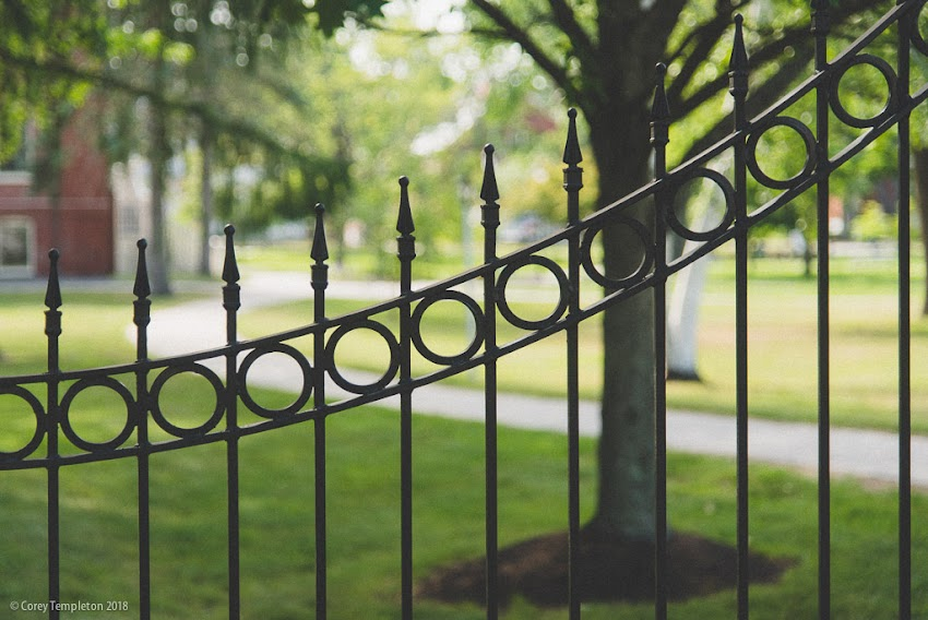 Portland, Maine USA June 2018 photo by Corey Templeton. A sloping fence design at the University of New England campus in Portland.