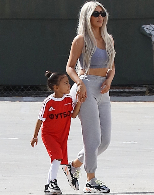 Kim Kardashian steps out with her cute kids (photos)