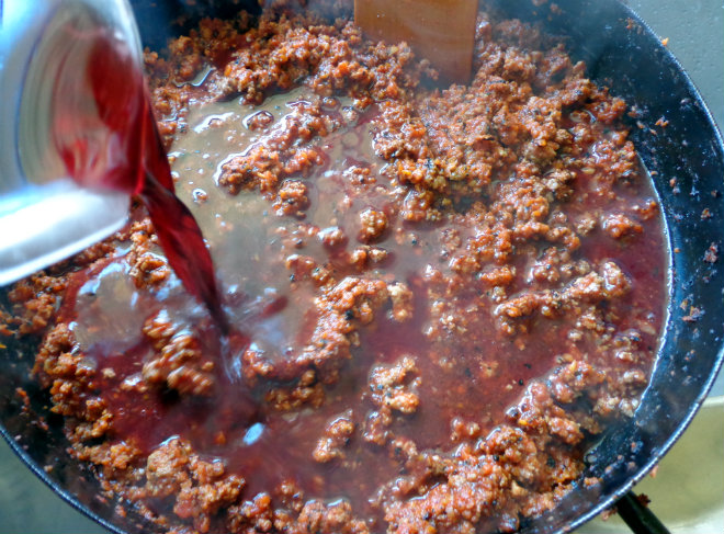 Whole-wheat spaghetti Bolognese by Laka kuharica: add the tomato puree, red wine, beef stock