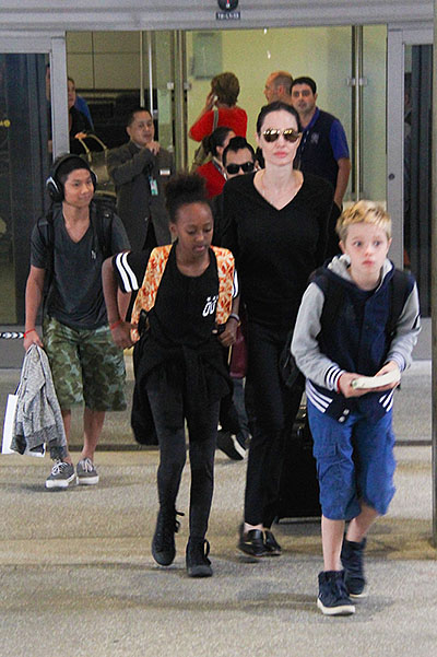 Angelina Jolie with kids at the airport in Los Angeles