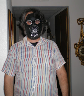 Man wearing a germ warfare mask.