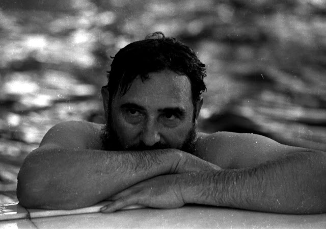 Image Attribute:  Then Cuban Prime Minister Fidel Castro relaxes in a swimming pool during a visit to Romania in this May 28, 1972 file photo. REUTERS/Prensa Latina/File Photo