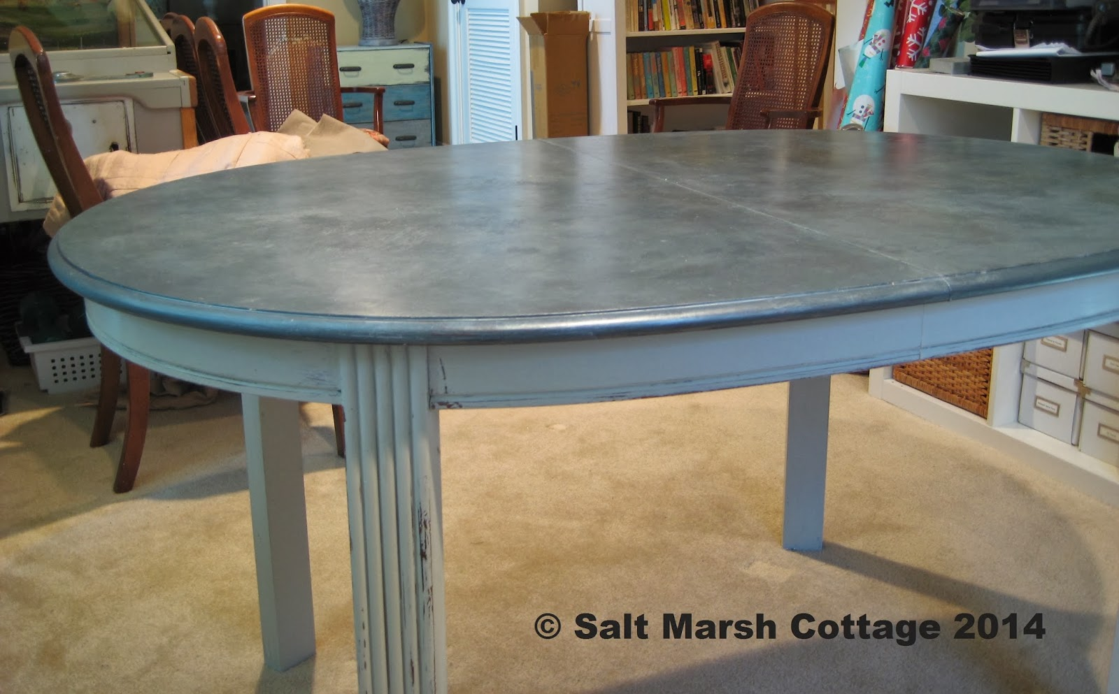 Epic  off table with the faux zinc finish that used to be our dining table before we got the larger farmhouse table It will be perfect for playing games and