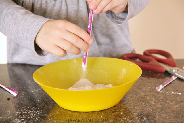 This sensory play dough recipe is so cool! Its made with Pixy Stix candy and smells amazing.  The best part is freezing the dough-its such a great fine motor strengthening activity and great for proprioceptive input to the hands.