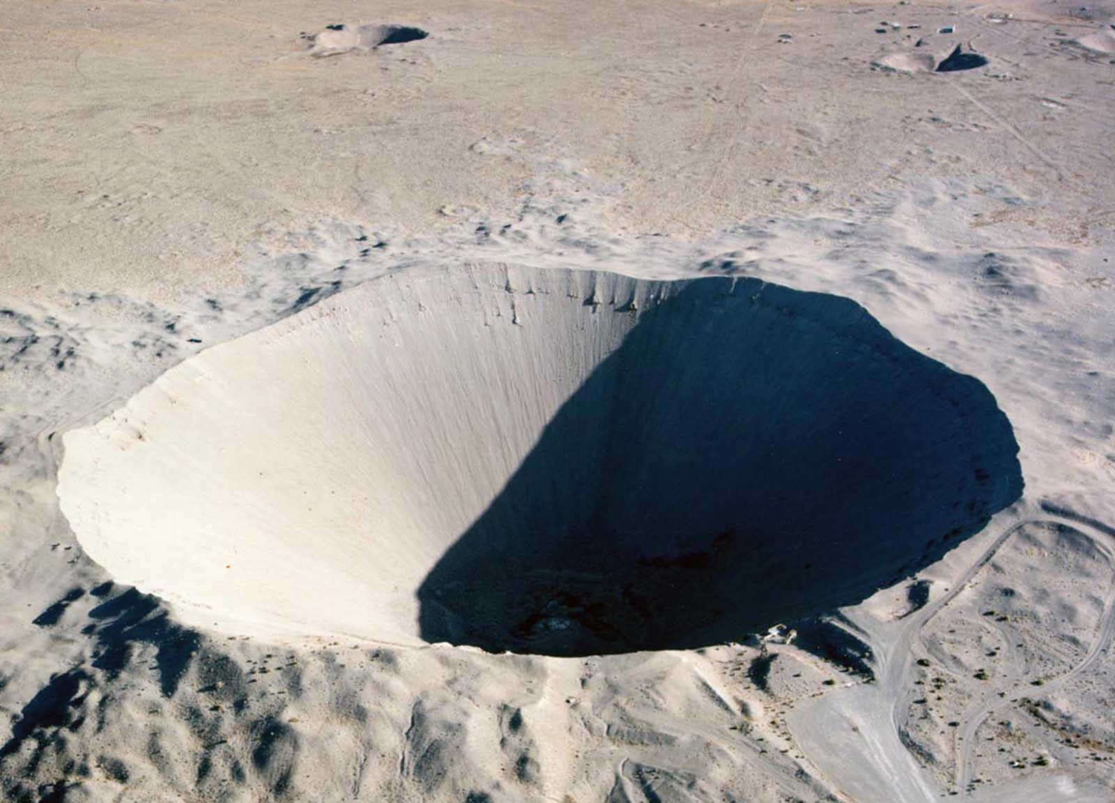 Sedan Crater was formed when a 100-kiloton explosive buried under 635 feet of desert alluvium was fired at the Nevada Test Site on July 6, 1962, displacing 12 million tons of earth. The crater is 320 feet deep and 1,280 feet in diameter.
